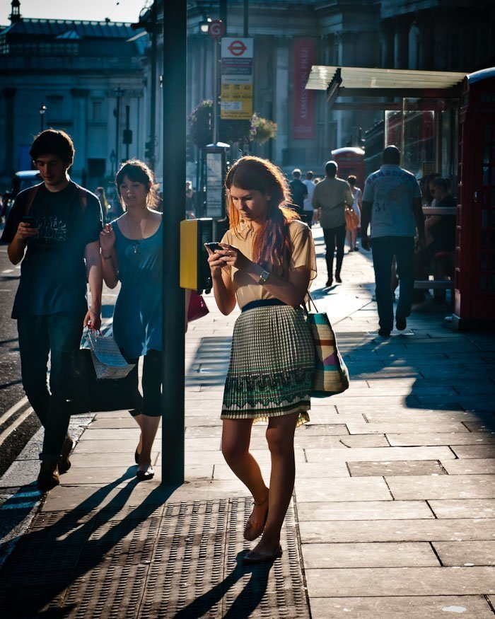 Candid street photograph of a fashionable girl in London, England