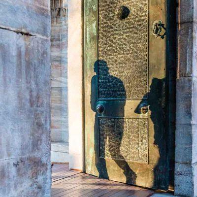 silhouette man door blue mosque istanbul