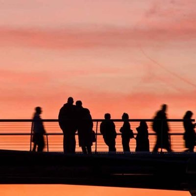 silhouette people couple bridge sunset