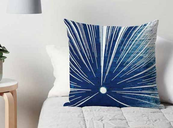 Stylish Printed Cushion on Bed